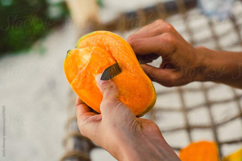 Eating a mango by Chris Werner for Stocksy United