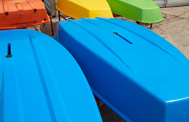 Colorful boats on the shore by Bratislav Nadezdic for Stocksy United