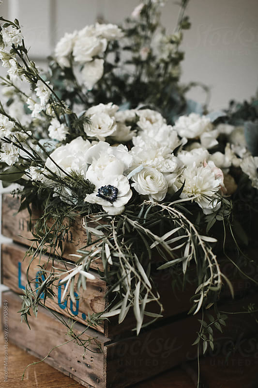 Flowers and greenery in wooden crate by Nicole Mason for Stocksy United