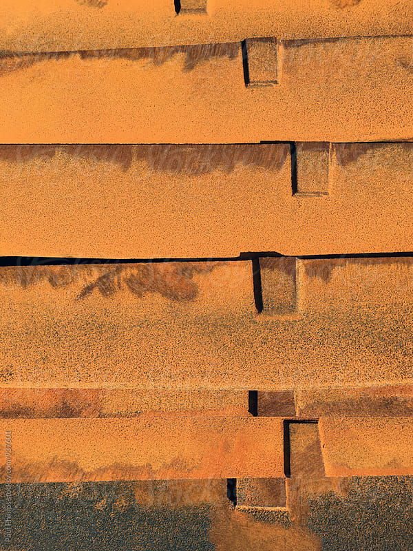 Vibrant orange rusting metal bars. by Paul Phillips for Stocksy United
