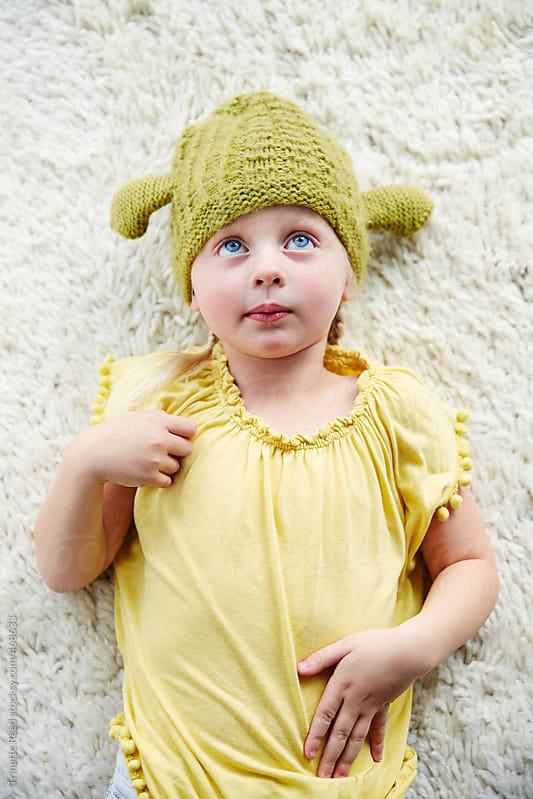 Portrait of cute little girl on floor  by Trinette Reed for Stocksy United