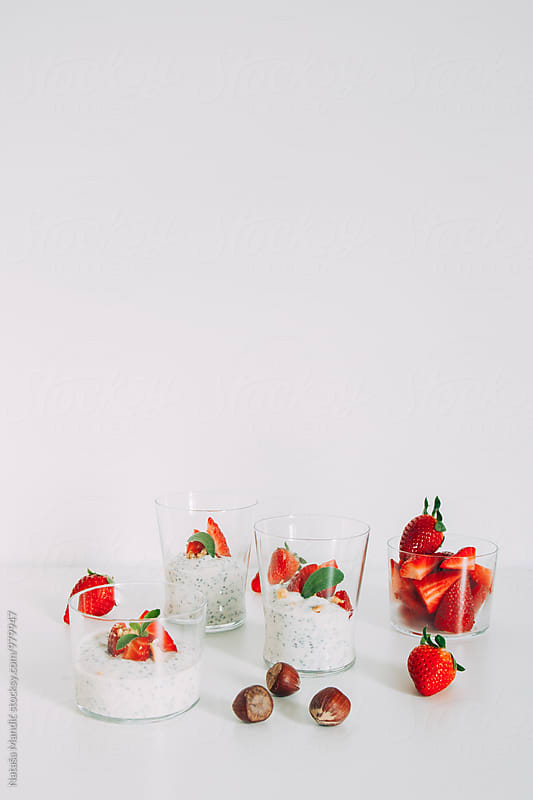 Chia yogurt with strawberries and hazelnuts by Nataša Mandić for Stocksy United