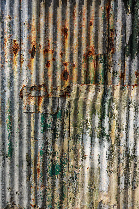 distressed galvanized aluminum wall by alan shapiro for Stocksy United