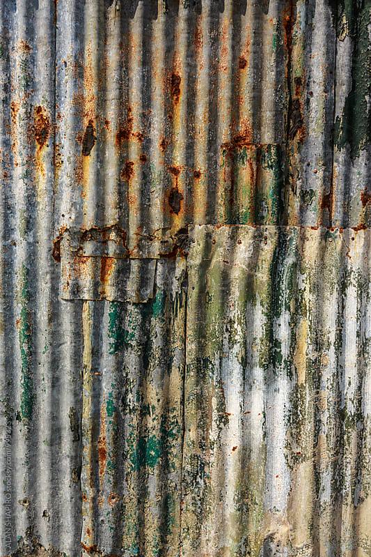 distressed galvanized aluminum wall by ALAN SHAPIRO for Stocksy United