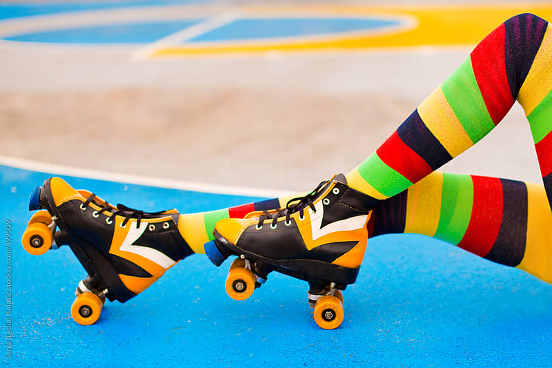 Colorful rollerskates on basketball playground by Sanja (Lydia) Kulusic for Stocksy United