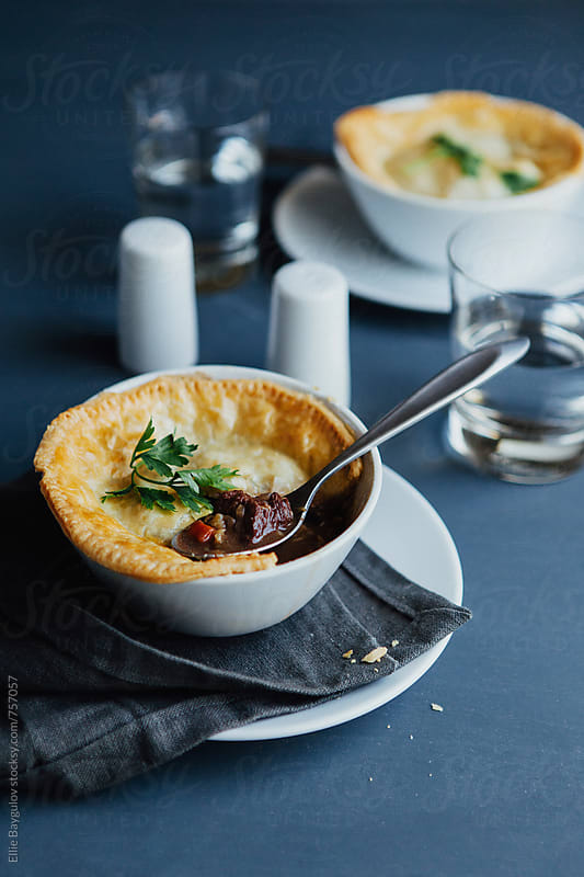 Beef pot pie by Ellie Baygulov for Stocksy United