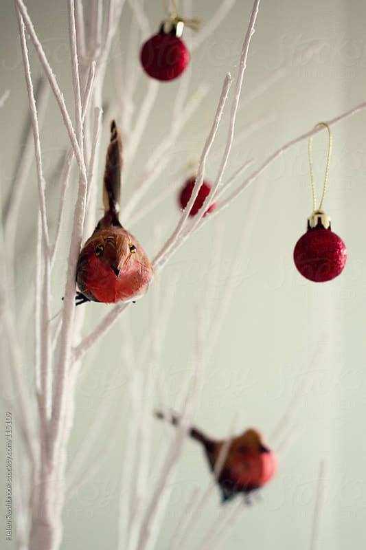 Robins and baubles on a white paper Christmas Tree by Helen Rushbrook for Stocksy United