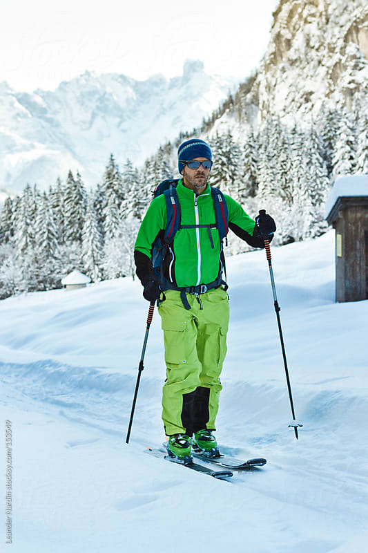 Portrait of a ski tourer in austian winter landscape by Leander Nardin for Stocksy United