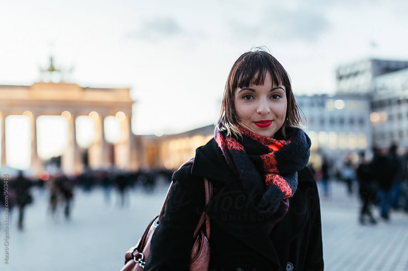 Woman walking on Berlin Streets by Mauro Grigollo for Stocksy United