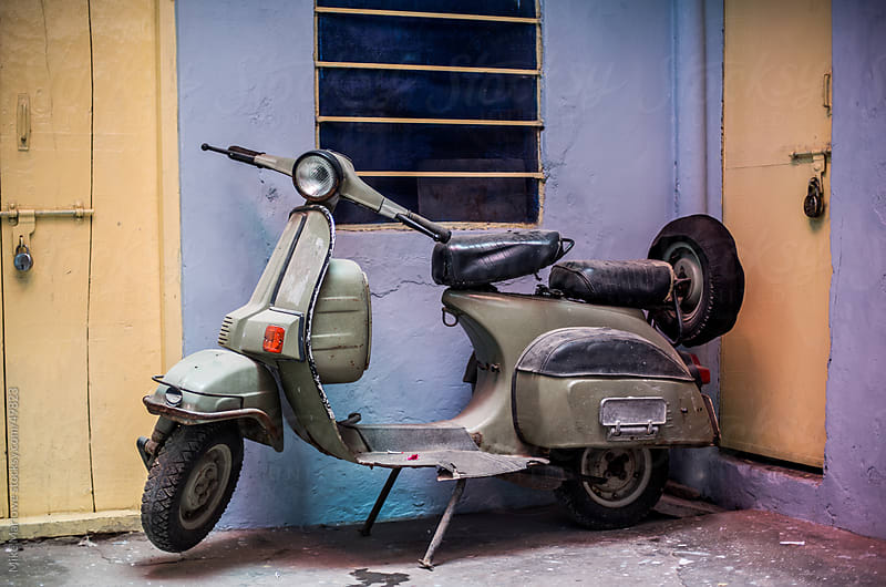 A scooter with color tones blending in to background. by Mike Marlowe for Stocksy United