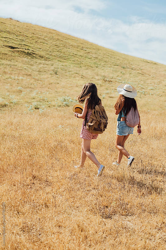 Two Women Hiking Together by Lumina for Stocksy United