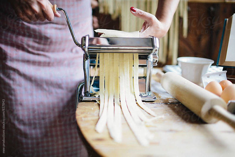 Making fresh pasta in a rural home. by mee productions for Stocksy United