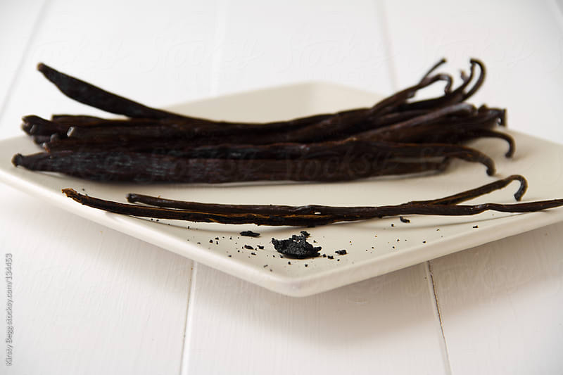 Vanilla pod split with seeds by Kirsty Begg for Stocksy United