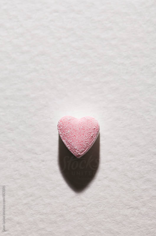 Valentine: Pink Sugar Candy On Textured White Background by Sean Locke for Stocksy United