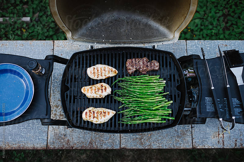 Food on the grill by Kristine Weilert for Stocksy United