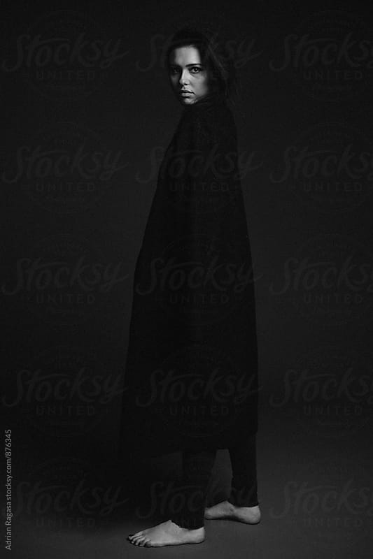 Woman in Long Coat by Adrian Ragasa for Stocksy United
