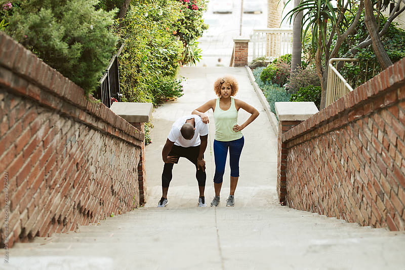 Pair of young African American friends working out together by Kate Daigneault for Stocksy United