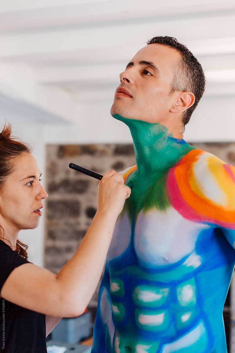 Making Of Of A Make Up Artist Working On A Man S Body Painting By Thais Varela Stocksy United