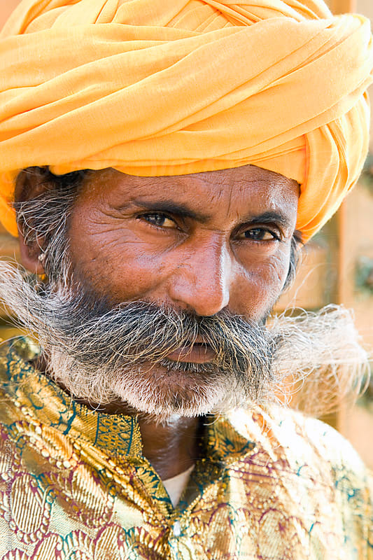 India, Rajasthan, Jaipur, portrait of a local man wearing a bright coloured turban by Gavin Hellier for Stocksy United
