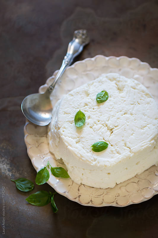 ricotta cheese with basil leaves by Laura Adani for Stocksy United