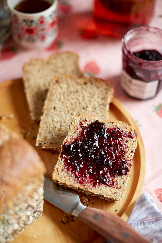 Delicious Bread coated with blueberry sauce on the table,closeup by ChaoShu Li for Stocksy United