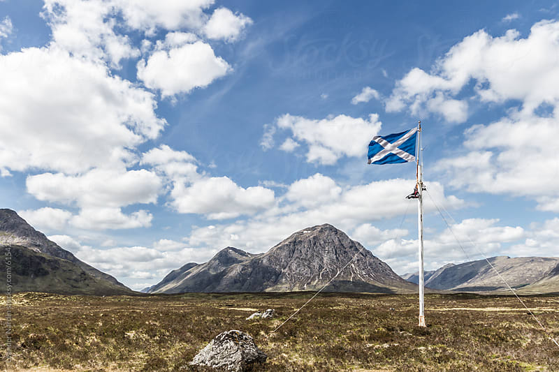 Scottish national flag in the highlands by Leander Nardin for Stocksy United