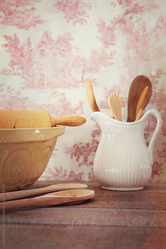 Mixing bowls with rolling pin on wooden table by Sandra Cunningham for Stocksy United