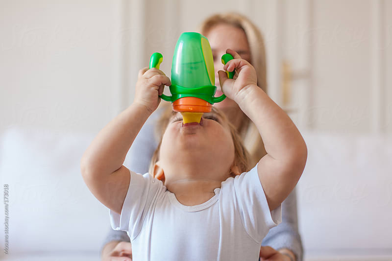 Cute Little Boy Drinking From His Bottle by Mosuno for Stocksy United