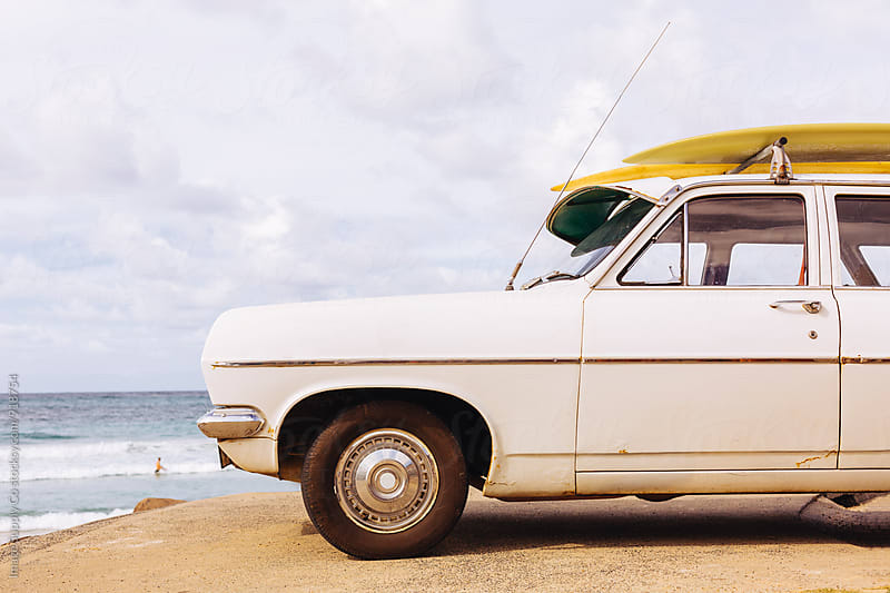 Surfing adventure/road trip at the beach on a sunny and cloudy day by Image Supply Co for Stocksy United