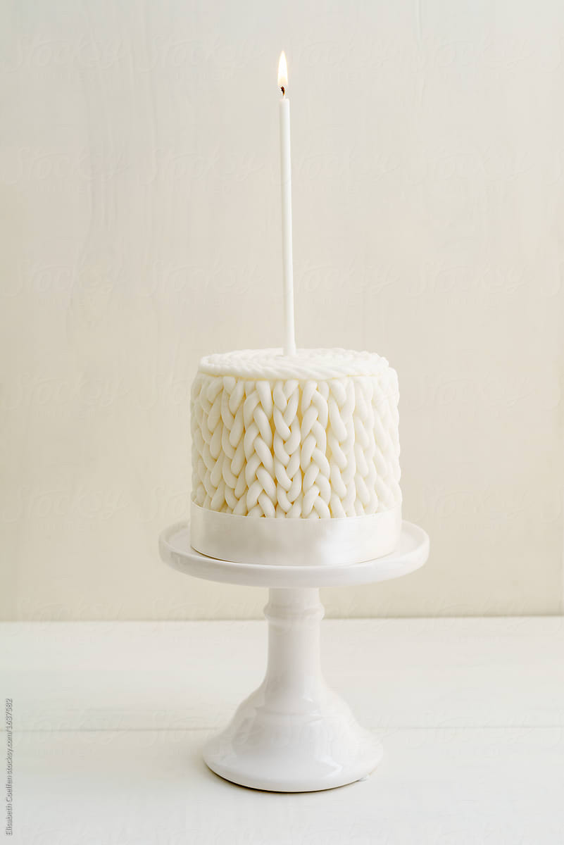 White Winter Birthday Cake With Knitted Pattern Made Of Fondant By Elisabeth Coelfen For Stocksy United