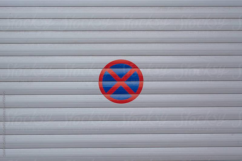 No parking sign on a garage door by Gabriel (Gabi) Bucataru for Stocksy United