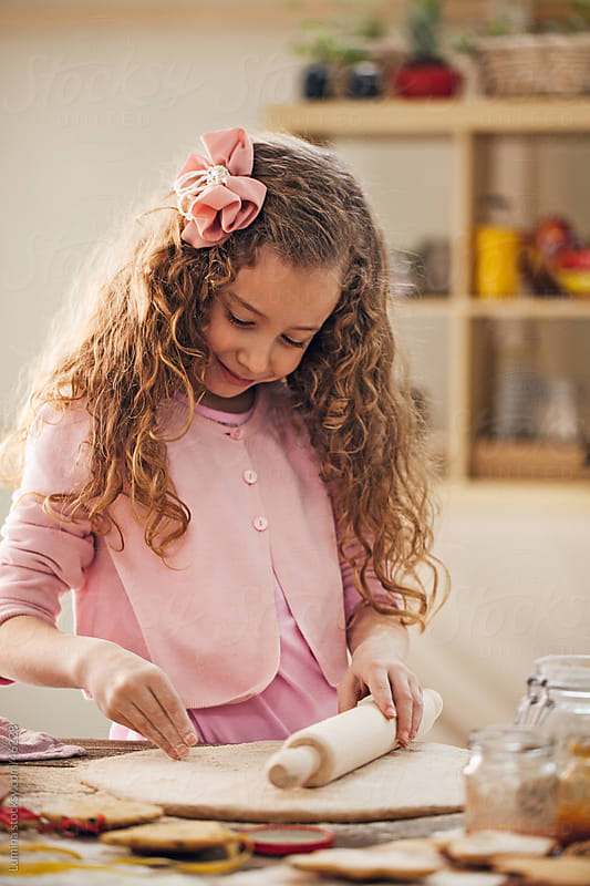 Girl Making Cookies by Lumina for Stocksy United