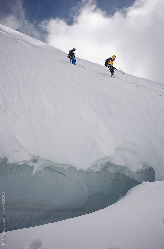 Mountaineering team descending the mountain  by RG&B Images for Stocksy United
