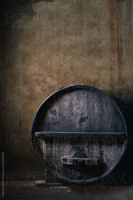 Old wine barrel in a cellar by Miquel Llonch for Stocksy United