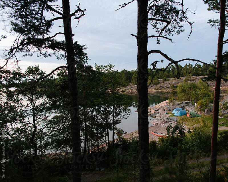 Camp on a beach on the edge of a forest by Denni Van Huis for Stocksy United