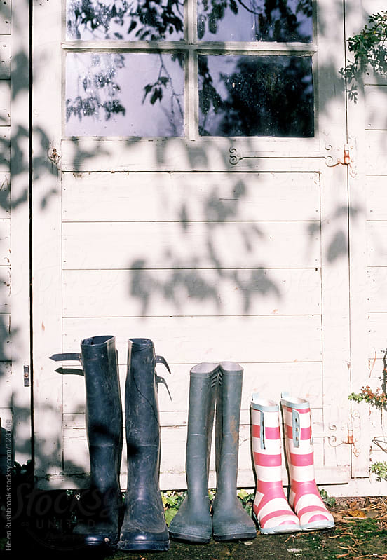 A family of boots by Helen Rushbrook for Stocksy United