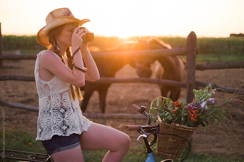Woman Taking Pictures of a Countryside  by Mosuno for Stocksy United