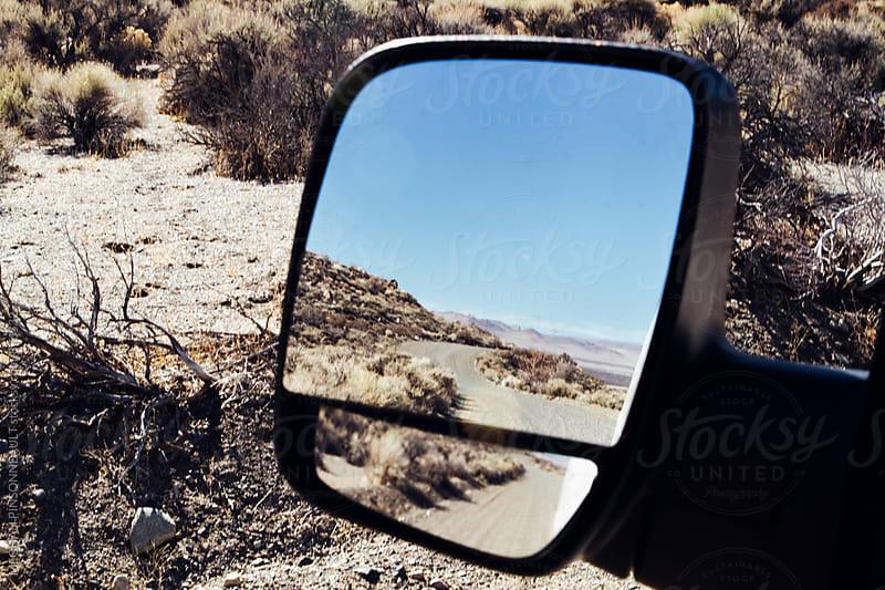 Reflection of Desert Landscape in Van Side Mirror  by Meg Pinsonneault for Stocksy United