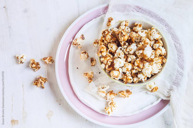 Salted caramel popcorn by Susan Brooks-Dammann for Stocksy United