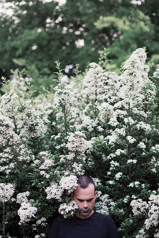 Man in white flowers by Jovana Rikalo for Stocksy United