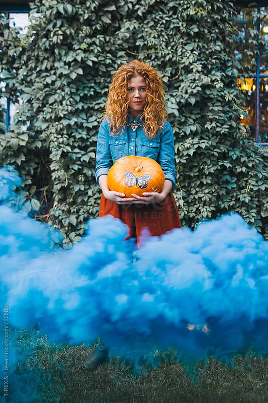 Woman holding orange pumpkin  by T-REX & Flower for Stocksy United