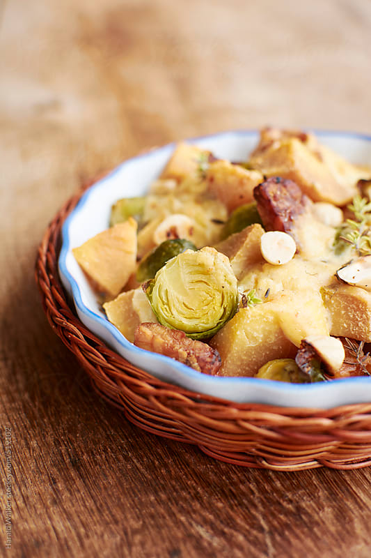 Tempeh, Brussels sprouts Quince Gratin by Harald Walker for Stocksy United