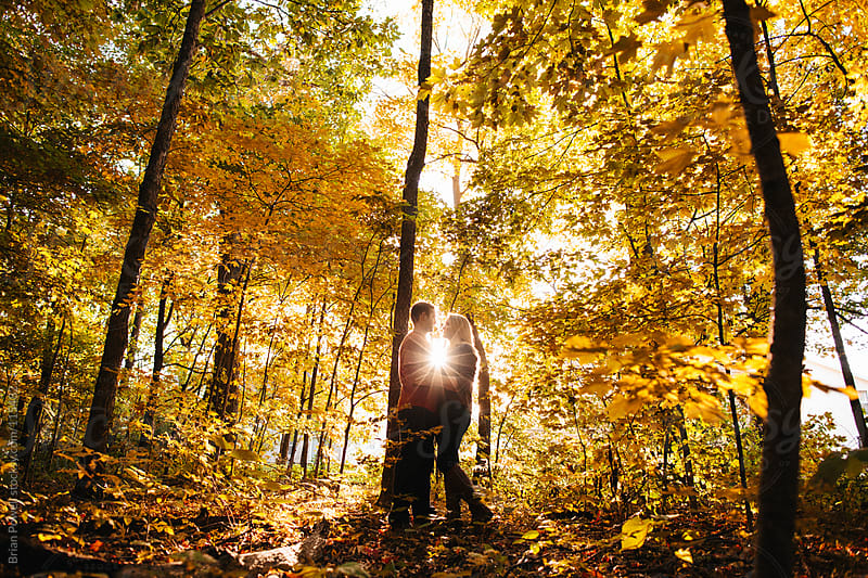 couple together in the forest by Brian Powell for Stocksy United