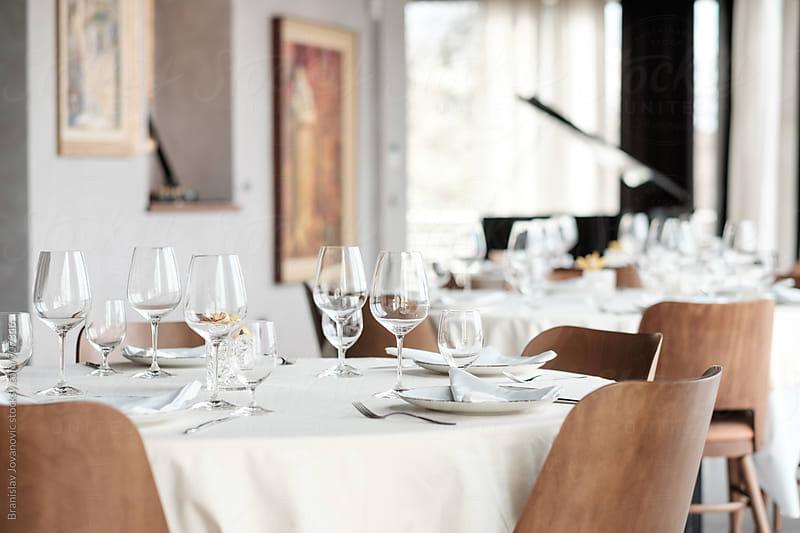 Vine Glasses on the Restaurant Table by Branislav Jovanović for Stocksy United