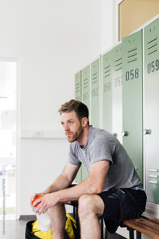 Athlete Sitting In Locker Room by minamoto images for Stocksy United