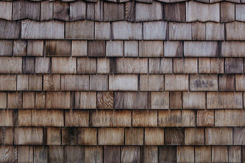 Weathered wooden shingle texture on a log cabin by Gabriel (Gabi) Bucataru for Stocksy United