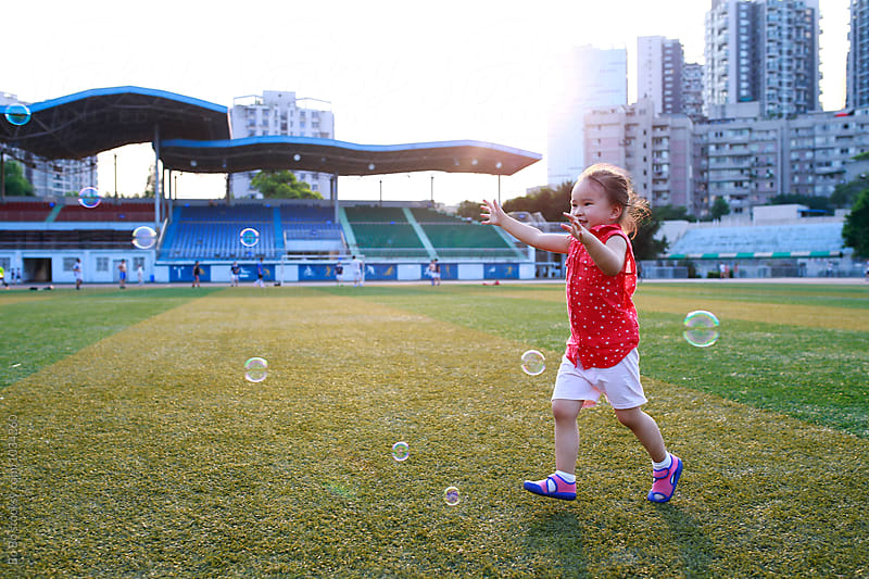 little asian girl after bubble outdoor in the playground by Bo Bo for Stocksy United