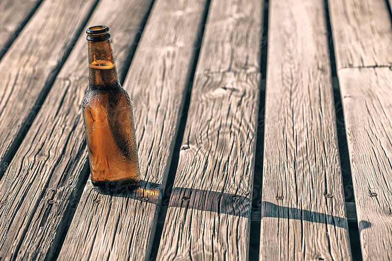 Cold beer on wooden background. by BONNINSTUDIO for Stocksy United