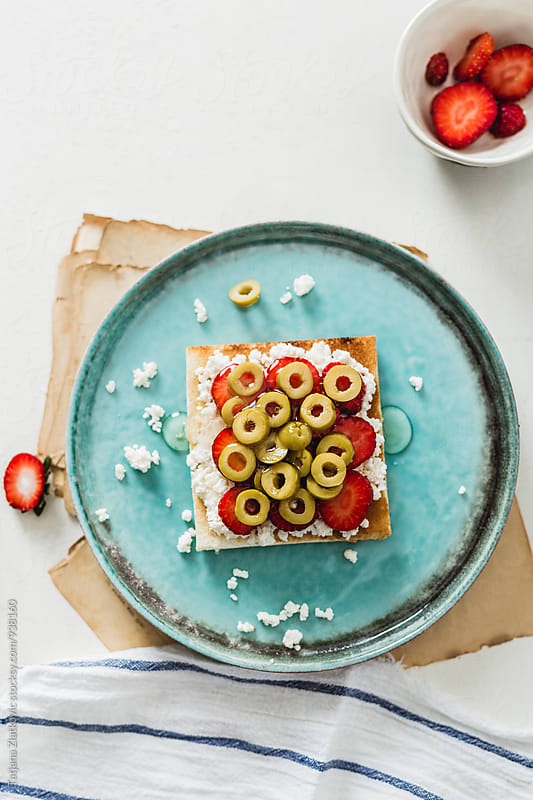 Strawberry sandwich with olives and honey by Tatjana Ristanic for Stocksy United