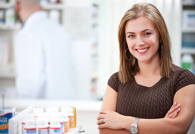 Pharmacy: Cheerful Pharmacy Customer by Sean Locke for Stocksy United